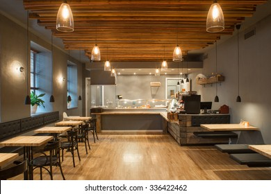 Interior of restaurant. Wooden design.