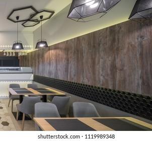 Interior of restaurant. Wooden, glass, srone, tile in design.