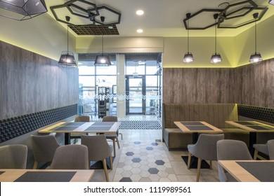 Interior of restaurant. Wooden, glass, stone, tile in design.