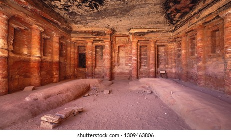 The interior of the Roman Soldier Triclinium, with its distinctive and fine architectural decorations once covered with painted stucco, Petra, Jordan