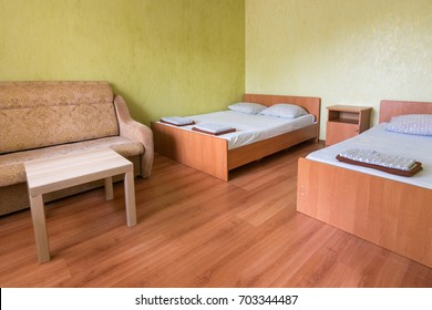 Interior of the room of a budget hotel with two beds