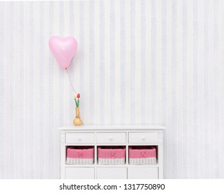 Interior room with cabinet, vase, flowers and balloon plus copy space for text.
