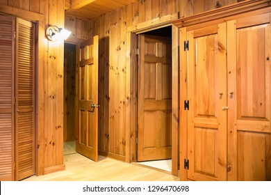 Interior of room with doors and wood paneling inside a beautiful wooden cabin