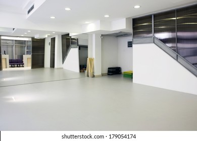 Interior of a room for exercise with large mirror
