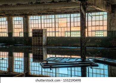 Interior of a room flooded with rain water with beautiful reflections.  Image taken at the old Scranton Lace Factory, built in 1890, closed in 2002, demolished in 2019.