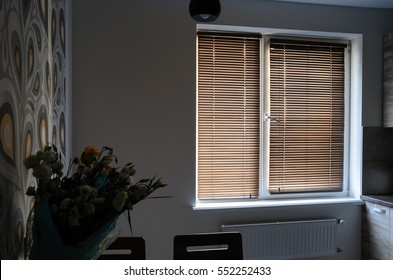 Interior room with wooden shutters on the window.