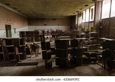 Interior of ruined, abandoned administrative, residential building after fire. Ruin; The ruins of an abandoned ruined house. As depressive background for thrash design