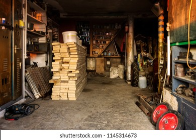 interior of a rural barn with a workshop and a repository of materials