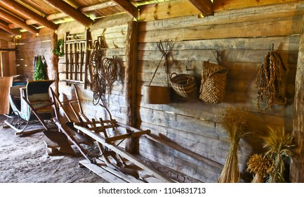 Interior of the Russian peasant hut. peasant sledge, plow, harrow, ropes, baskets in the barn