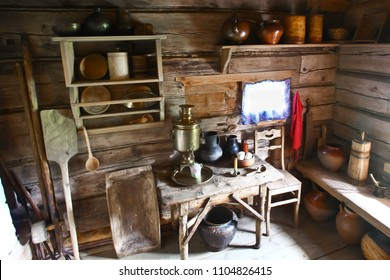 Interior of the Russian peasant hut.Kitchen interior, samovar, pots, kitchen utensils, oven