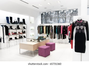 Interior of shopping. Clothing sales point women