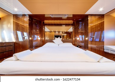 An interior shot of a big bedroom in the yacht