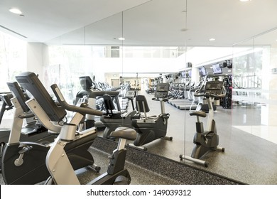 An interior shot of a club gym with all the execrise equipments