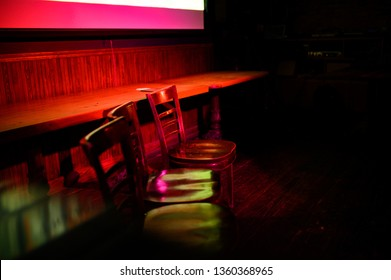 Interior shot of a dimly-lit back room of a bar in Brooklyn, NY.