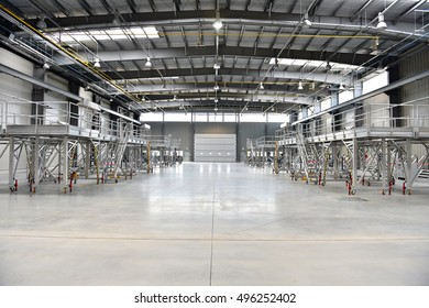 Interior shot with an empty new industrial warehouse