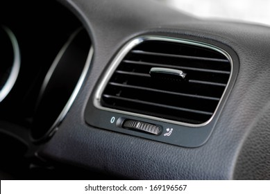 interior shot of modern car air vent with on/off switch