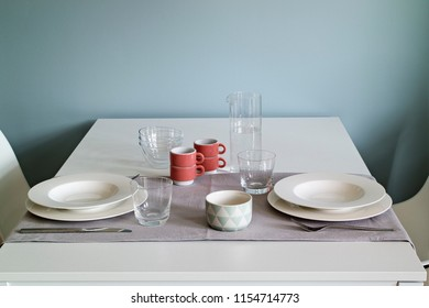 interior shot of a modern dining room in the foreground the dining table with dishes