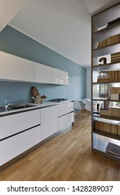 interior shot of a modern white lacquered kitchen