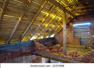 Interior shot of unfinished single-family house attic