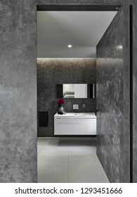 interior shots of a modern bathroom in the foreground the white washbasin furniture
