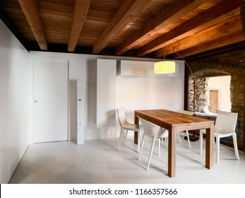 interior shots of a modern dining room with wooden table the ceiling made of wood and the floor made of resin