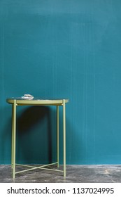 Interior with side table on blue wall