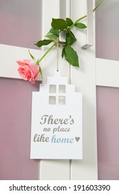 Interior with sign no place like home and pink rose