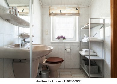 Interior of a small bathroom with vintage sanitary ware