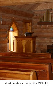 Interior Of A Small Log Church In The Country