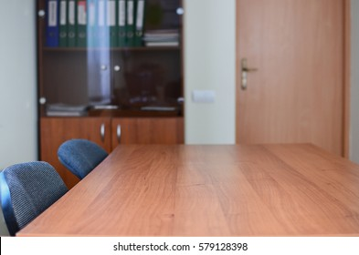 Interior of a small office cabinet (room) with big table for negotiations. Copy space