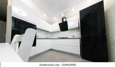 interior of a small white kitchen.