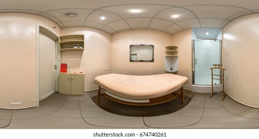 Interior of a spa massage room in fitness centre with empty table bed full 360 degree panorama in equirectangular spherical projection