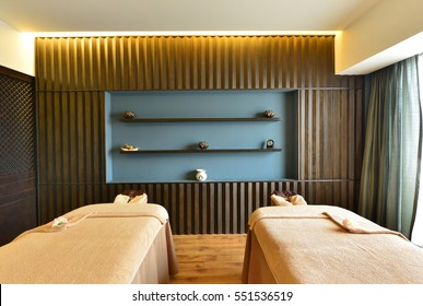 Interior of Spa room consisting of bench pillows towels and low level lighting