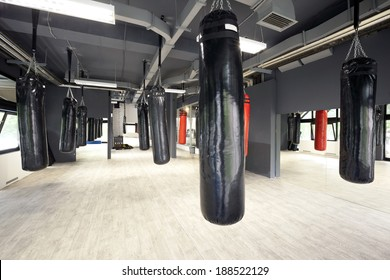 Interior of a spacious gym with punching bags
