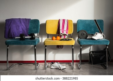 Interior sports gym concept, sneakers, dumbbell, bag and towels - Room of a teenager being active