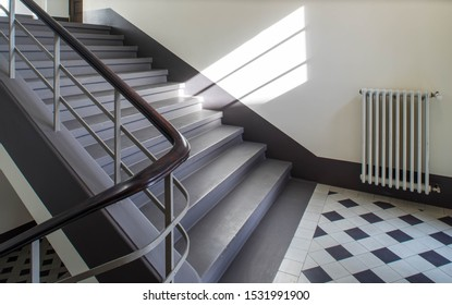 Interior of staircase in modern building. Heating system.