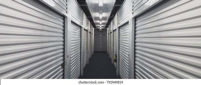 Interior storage units. Looking down a hallway with metal doors on both sides.