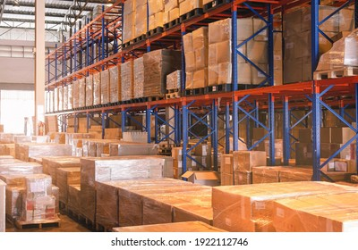 Interior of Storage Warehouse. Package Boxes in Storage with Tall Shelves. Industry Manufacture Warehousing.