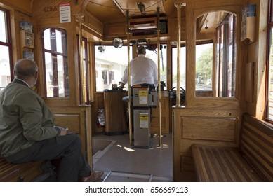 The interior of a streetcar with the motorman driving. Tampa Florida USA. April 2017