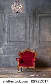 Interior studio - red old vintage armchair in a dark studio