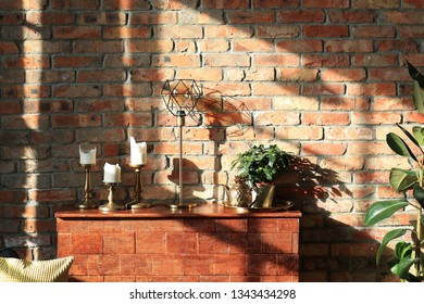 Interior. Sunny day in a room with brick wall