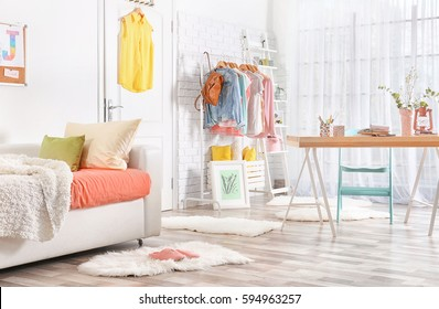 Interior of teenage girl's room with sofa