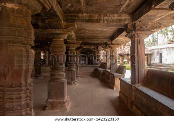 Interior of temple with stone carving and sculpture