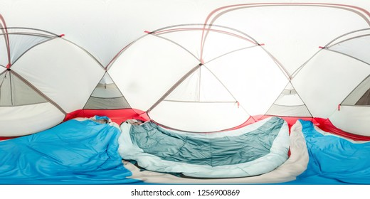 Interior tent inside view, two sleeping bags, mats. Spherical panorama 360vr