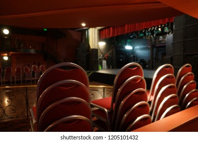 Interior theatre seating with stage background