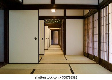 Interior of traditional Japanese house with sliding doors and tatami