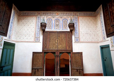 The interior of a traditional room in the Marrakesh Museum of Photography with its distinctive Moroccan and Islamic style of woodwork and arabic and north african decor.