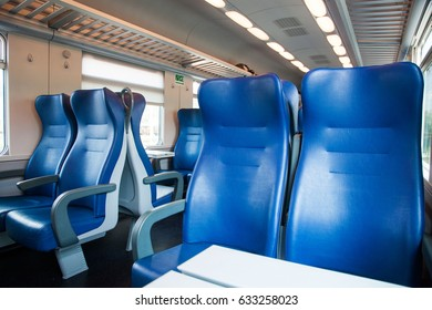 interior of a train wagon with empty seats