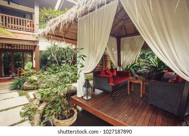 Interior of Tropical alcove in luxury hotel resort outdoor with tropical garden