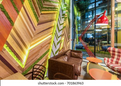 Interior of a urban restaurant interior with green plants on the wall